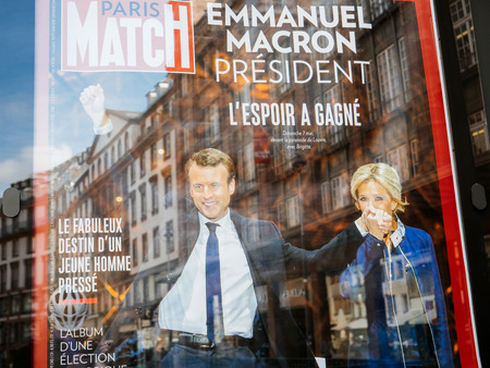handover: STRASBOURG, FRANCE - MAY 15, 2017: French city press kiosk with Paris Match magazine with Emmanuel Macron and his wife Brigitte Trogneux during handover ceremony presidential inauguration of the newly elected French President Emmanuel Macron in Paris, Fra