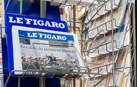 handover: PARIS, FRANCE - MAY 15, 2017: Le Figaro French newspaper reporting handover ceremony presidential inauguration of the newly elected French President Emmanuel Macron in Paris, France Editorial