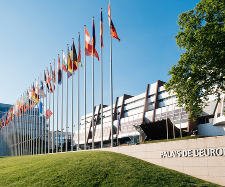 STRASBOURG, FRANCE - MAY 26, 2017: European Union and the United Kingdom flags fly half-mast Council of Europe building memory of victims terrorist explosion Manchester Arena Ariana Grande concert