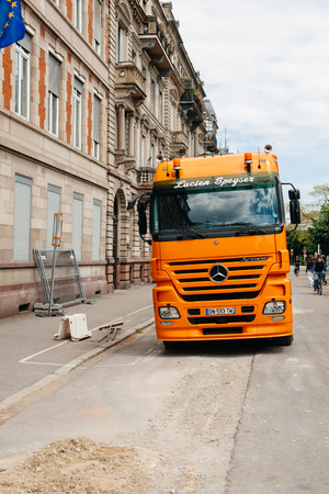STRASBOURG, FRANCE - MAY 18, 2016: Mercedes-Benz Actros 2660 truck transporting construction excavator at the construction site in urban environment during roadwork Editorial