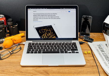 high sierra: PARIS, FRANCE - JUNE 6, 2017: Apple Computers website on MacBook Retina in creative environment showcasing latest news from Apple at WWDC 2017 - iPad pencil on the iPad pro caligraphy