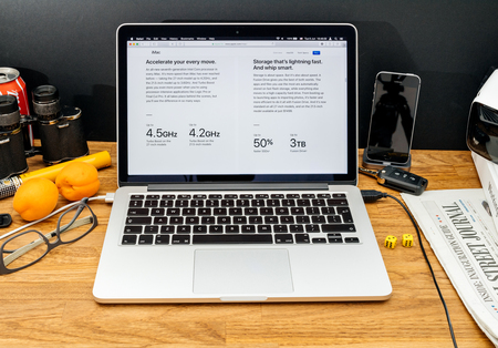 high sierra: PARIS, FRANCE - JUNE 6, 2017: Apple Computers website on MacBook Retina in creative environment showcasing latest news from Apple at WWDC 2017 - faster CPU and SSD for mac