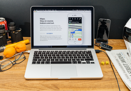 high sierra: PARIS, FRANCE - JUNE 6, 2017: Apple Computers website on MacBook Retina in creative environment showcasing latest news from Apple at WWDC 2017 - apple maps lane guidance in ios 11