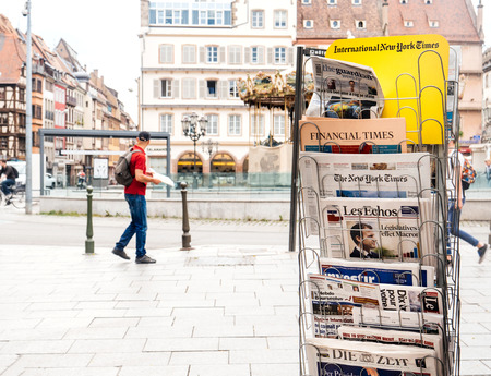 en: STRASBOURG, FRANCE - JUN 12, 2017: Place Gutenberg press kiosk with international and French newspapers with reactions to French legislative election, 2017 a day after first round Editorial