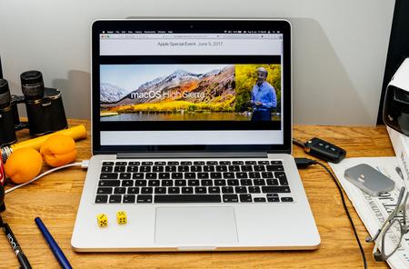 sierra: PARIS, FRANCE - JUNE 6, 2017: Apple Computers website on MacBook laptop in creative environment showcasing Apple Craig Federighi previews macOS High Sierra at WWDC 2017 - presentation of new name Editorial