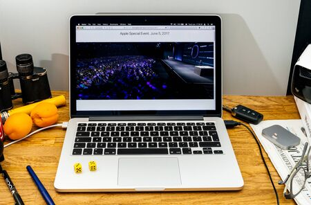 sierra: PARIS, FRANCE - JUNE 6, 2017: Apple Computers website on MacBook laptop in creative environment showcasing news from Apple at WWDC 2017 - large auditorium Editorial