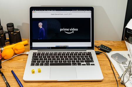 high sierra: PARIS, FRANCE - JUNE 6, 2017: Apple Computers website on MacBook laptop in creative environment showcasing news from Apple at WWDC 2017 - announcing Amazon Prime Video on Apple TV