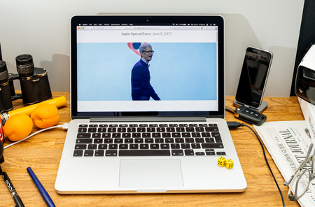 high sierra: PARIS, FRANCE - JUNE 6, 2017: Apple Computers website on MacBook Retina in creative environment showcasing Tim Cook welcomes developers from 75 different countries WWDC 2017 Editorial