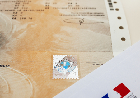 registry: PARIS, FRANCE - OCT 26, 2016: Front view of the vehicle registration certificate (certificat dimmatriculation known also as carte grise) with special holographic protection stamp issued by the Ministry of Interior of France. A vehicle registration certif