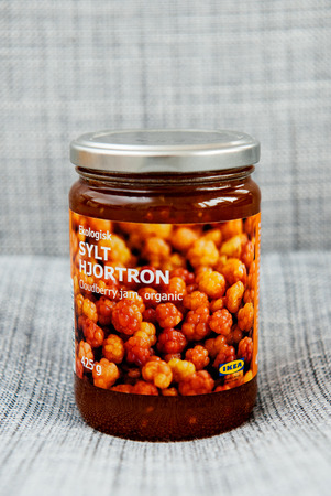 chicouté: PARIS, FRANCE - OCT 25, 2016: IKEA food package - Swedish jam made from organic cloudberry fruits. IKEA Foods is a division of IKEA furniture. IKEA is a Scandinavian chain selling ready-to-assemble furniture, plus housewares, in a warehouse-like space.
