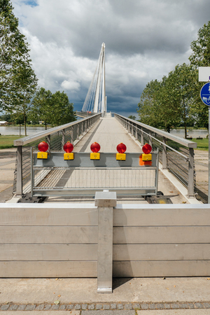 KEHL, GERMANY - JUN 18, 2016: Closed Friendship bridge between France and Germany due to flooded Rhine river at the border with France. In june large bodies of water has caused inundation of adjacent areas near the river.