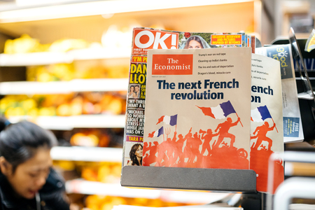 LONDON, UNITED KINGDOM - MAR 8, 2017: Cover of The Economist financial magazine at British press kiosk newsstand featuring headlines with the Next French revolution