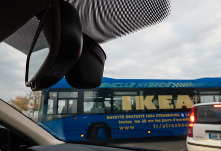 STRASBOURG, FRANCE - OCT 21, 2016: Defocused view of Hybrid IKEA blue bus - driver point of view from inside the adjacent passing car