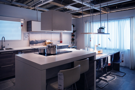 PARIS, FRANCE - OCT 21, 2016: Luxury kitchen furniture and kitchen appliances in the modern IKEA shopping furniture mall in Paris
