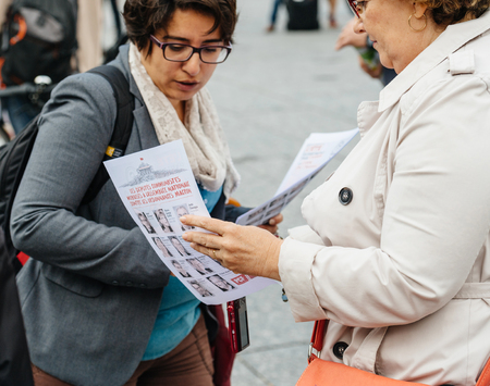populist: STRASBOURG, FRANCE - JUL 12, 2017: Senior woman debating at protest against Macron government spending cuts and pro-business tax and labor reforms