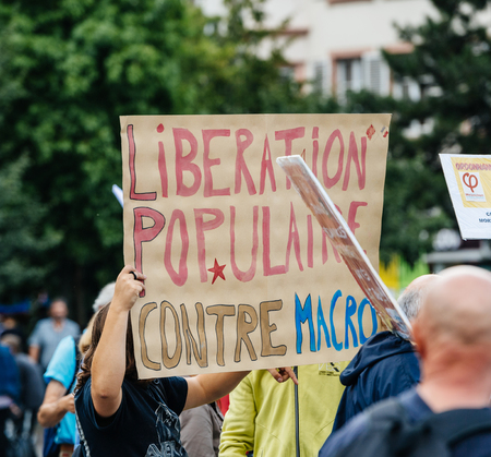 populist: STRASBOURG, FRANCE - JUL 12, 2017: Large crowd of protesters in city as Melenchon called for day of protest against Macron government spending cuts and pro-business tax and labor reforms