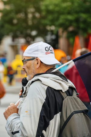 addressing: STRASBOURG, FRANCE - JUL 12, 2017: Man addressing to protesters in city as Melenchon called for day of protest against Macron government spending cuts and pro-business tax and labor reforms