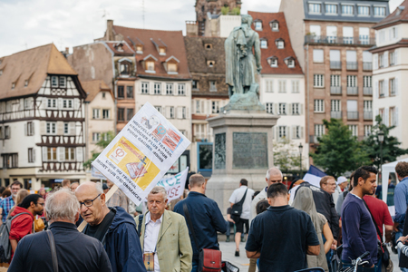 populist: STRASBOURG, FRANCE - JUL 12, 2017: Group of protesters in city as Melenchon called for day of protest against Macron government spending cuts and pro-business tax and labor reforms