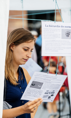 STRASBOURG, FRANCE - JUL 12, 2017: People reading manifests in city as Melenchon called for day of protest against Macron government spending cuts and pro-business tax and labor reforms