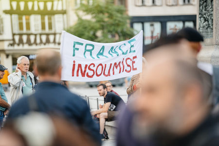 STRASBOURG, FRANCE - JUL 12, 2017: Crowd of protesters in city as Melenchon called for day of protest against Macron government spending cuts and pro-business tax and labor reforms
