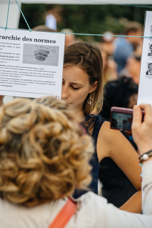 populist: STRASBOURG, FRANCE - JUL 12, 2017: People reading manifests in city as Melenchon called for day of protest against Macron government spending cuts and pro-business tax and labor reforms