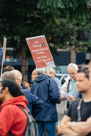 gewerkschaft: STRASBOURG, FRANCE - JUL 12, 2017: Young and senior people with placards at protest against Macron government spending cuts and pro-business tax and labor reforms