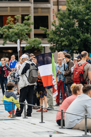 populist: STRASBOURG, FRANCE - JUL 12, 2017: French flag with protesters in city as Melenchon called for day of protest against Macron government spending cuts and pro-business tax and labor reforms Editorial