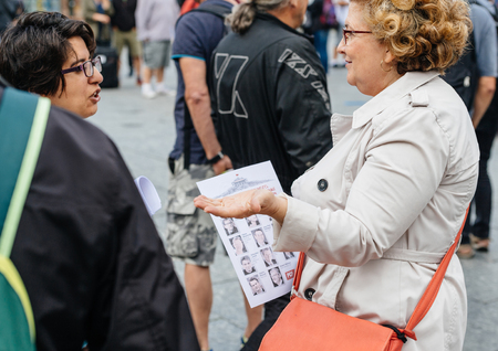 populist: STRASBOURG, FRANCE - JUL 12, 2017: Senior women debating at protest against Macron government spending cuts and pro-business tax and labor reforms