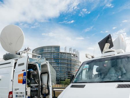 sattelite: STRASBOURG, FRANCE - JUN 30, 2017: TV Media Television Trucks with multiple equipment Satellite parabolic antennas and fiber optic cables preparing to report live the official European Ceremony of Honour for Dr. Helmut Kohl at European Parliament