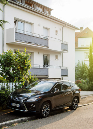 silver background: STRASBOURG, FRANCE - CIRCA 2017: New Luxury Hybrid Lexus RX 450h SUV parked on a street in France