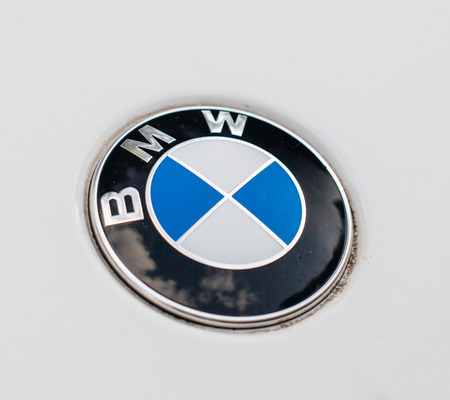 MUNCHEN, GERMANY - MAY 30, 2017: White BMW electric limousine with metallic BMW logotype insignia. Editorial