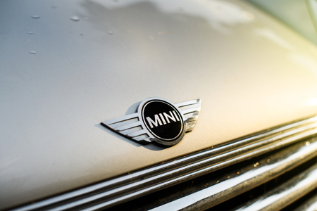 STRASBOURG, FRANCE - may 30, 2017: Silver Mini Cooper car parked in the city with prominent MINI logotype insignia