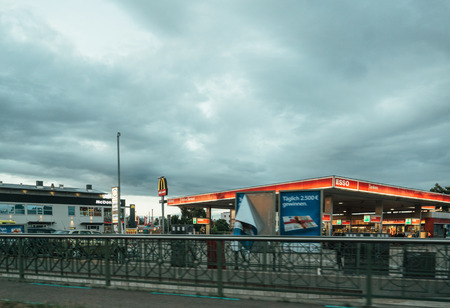 KEHL, GERMANY - JUNE 30, 2017: Esso petrol fuel station in Germany city - view from the car in motion. Esso is an American brand that is the American trade name for ExxonMobil and its related companies. Editorial