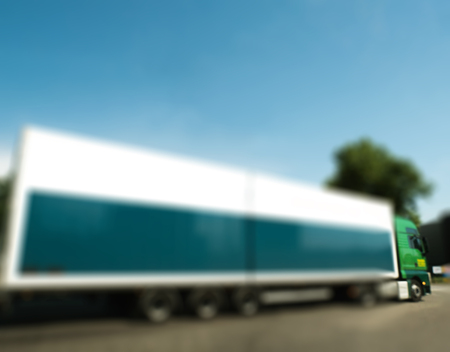 delivery truck: Defocused blur truck with white and blue trailer from transporting cargo loads to numerous destinations