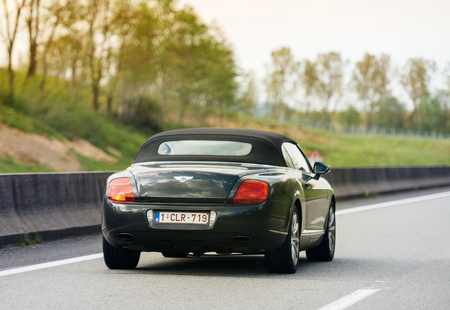 PARIS, FRANCE - MAY 7, 2017: Luxury Bentley Cabriolet driving fast on Frnech highway