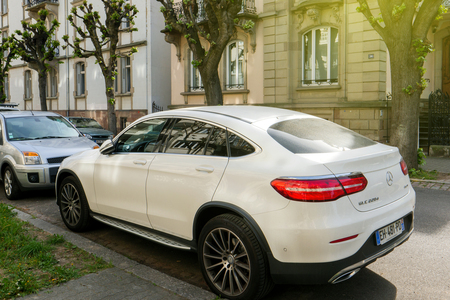 STRASBOURG, FRANCE - APR 12, 2017: Luxury Mercedes-Benz GLC 220 car parked in center of typical French city of Strasbourg. is a compact luxury SUV introduced in 2015 for the 2016 model year that replaces the former Mercedes-Benz GLK-Class