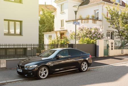 STRASBOURG, FRANCE - APR 28, 2017: Elegant executive black BMW German car parked on the Rue Gotfried in calm Strasbourg neighborhood.