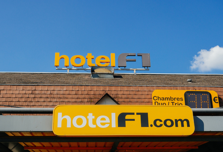 formule: PARIS, FRANCE - APR 28, 2017: Hotel Formula 1 signage on the roof of a cheap hotel. Hotel Formule 1, or hotelF1 in France, is an international chain of