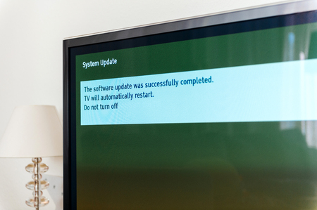 Message on TV screen plasma - the installation was successfully updated. Do not turn off, tv will automatically restarted Reklamní fotografie