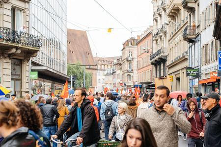 STRASBOURG, FRANCE - SEPT 12, 2017: Large crowd at at political march during a French Nationwide day of protest against the labor reform proposed by Emmanuel Macron Government