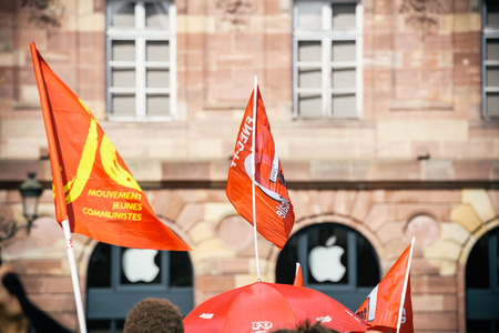 STRASBOURG, FRANCE - SEPT 12, 2017: Young communist movement flags at political march during a French Nationwide day of protest against the labor reform proposed by Emmanuel Macron Government