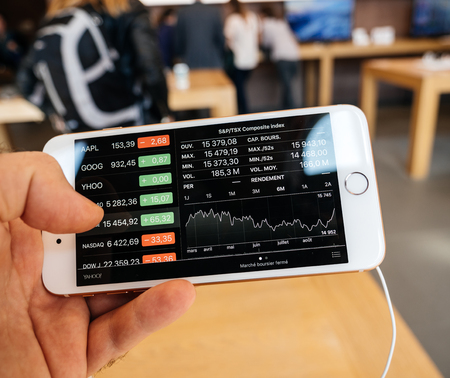 PARIS, FRANCE - SEP 22, 2017: New iPhone 8 and iPhone 8 Plus, as well the updated Apple Watch, Apple TV goes on sale today in Apple Store with customer looking at standard and poors composite index,