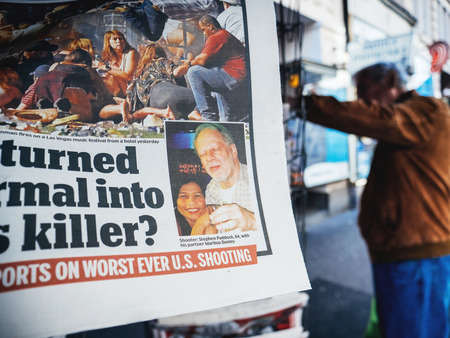 PARIS, FRANCE - OCT 3, 2017: Photo of killer Stephen Paddock in newspaper with socking title and photo at press kiosk about the 2017 Las Vegas Strip shooting in United States with about 60 fatalities and 527 injuries