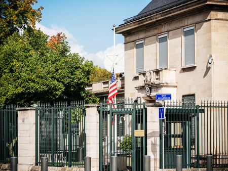 PARIS, FRANCE - OCT 3, 2017: US United States American Flag flying half-mast in court of the US Embassy after the 2017 Las Vegas Strip shooting in United States with about 60 fatalities and 527 injuries Editorial