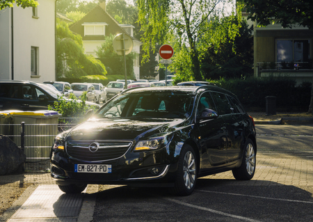 STRASBOURG, FRANCE - JUN 27, 2017: New black Opel mid-size luxury wagon car parked in a residential district in a French city