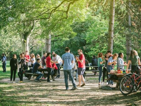 entertaining area: STRASBOURG, FRANCE - SEP 24, 2017: Young people group or students at a team-building and entertaining event in a public park picnic area Editorial