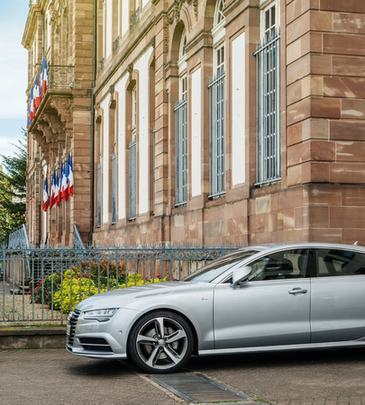 STRASBOURG, FRANCE - OCT 1, 2017: Side view of Luxury Audi A8 S-Line car parked in front of the City Hall of Strasbourg
