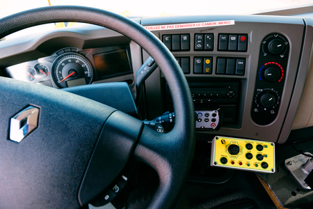 PARIS, FRANCE -SEPT 5, 2014: Interior of modern Renault Industrial sewer cleaning truck with vacuum and hydro excavation - buttons, steering wheel, dashboard command Editorial