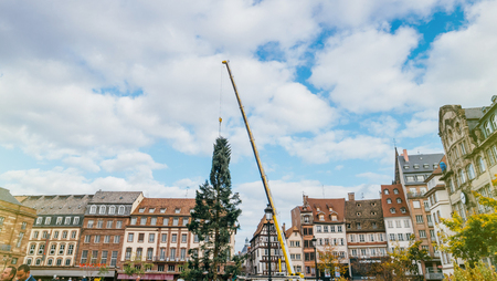 STRASBOURG, FRANCE - OCT 30, 2017: Panoramic Architecture with Strasbourg Christmas Tree Install in central Place Kleber Square by gigantic crane for the upcoming winter holidays