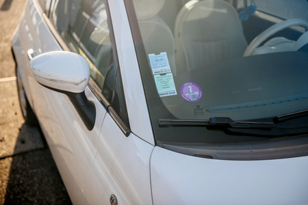 STRASBOURG, FRANCE - NOV 1, 2017: Mandatory  Air Quality Certificate Crit'Air certifying the vehicle's environmental class based on pollutant emissions - sticker on windshield Editoriali